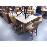 AN ART DECO DINING ROOM SUITE COMPRISING OF A BREAKFRONT SIDEBOARD OF FOUR GRADUATED CENTRAL