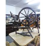 AN ANTIQUE LARGE SPINNING WHEEL