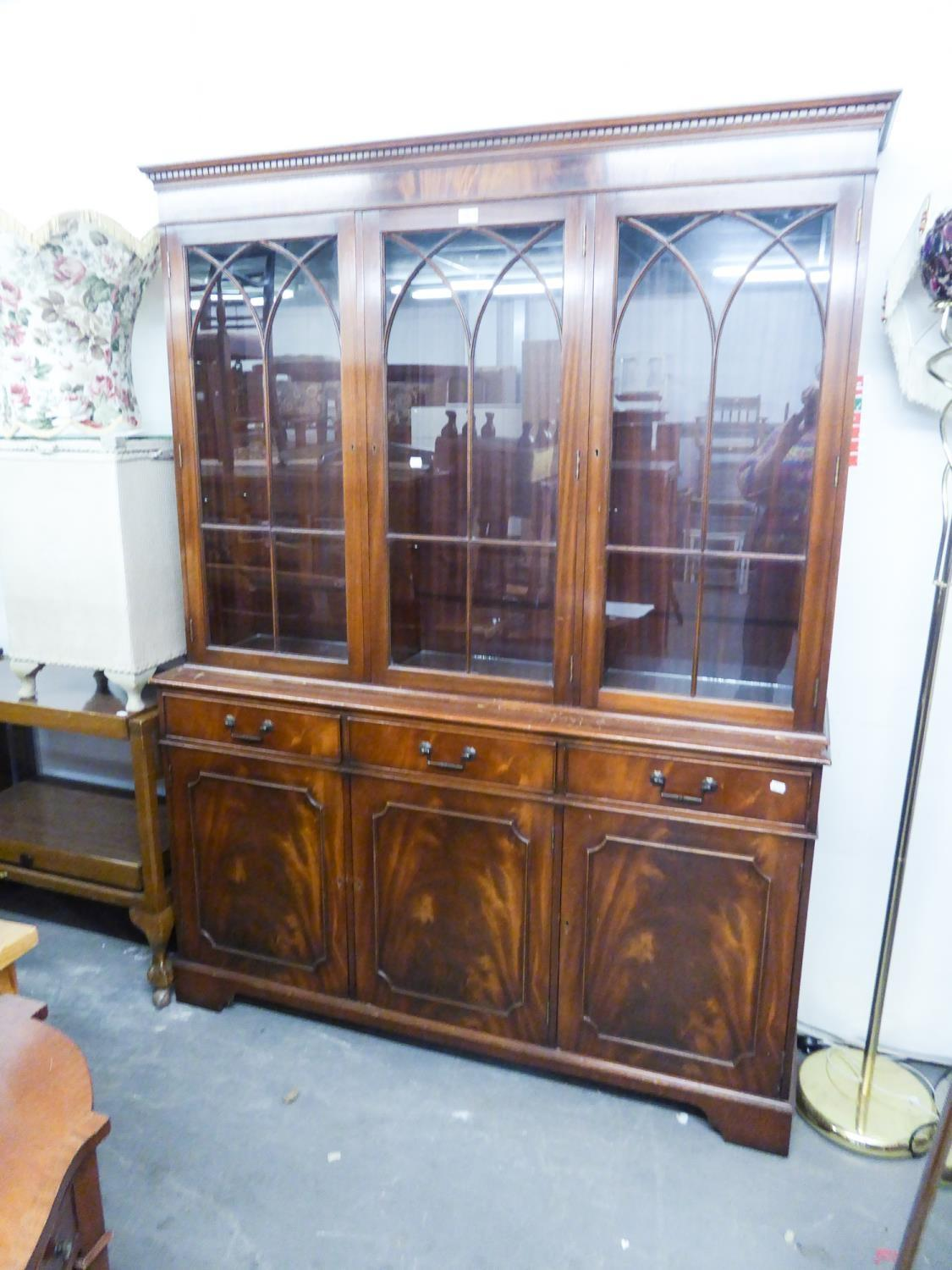 Lot 75 - A MODERN REPRODUCTION MAHOGANY BOOKCASE, WITH ASTRAGAL GLASS UPPER SECTION, DRAWERS AND CUPBOARDS