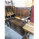 SMALL CARVED OAK MONKS BENCH