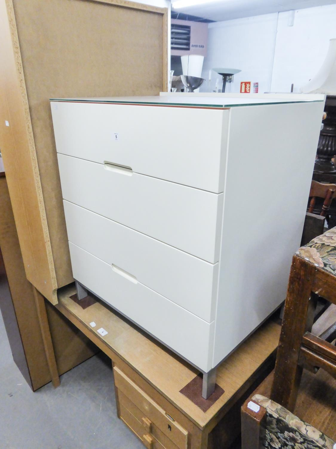 A MODERN WHITE HIGH GLOSS CHEST OF FOUR DRAWERS, RAISED ON STEEL BASE