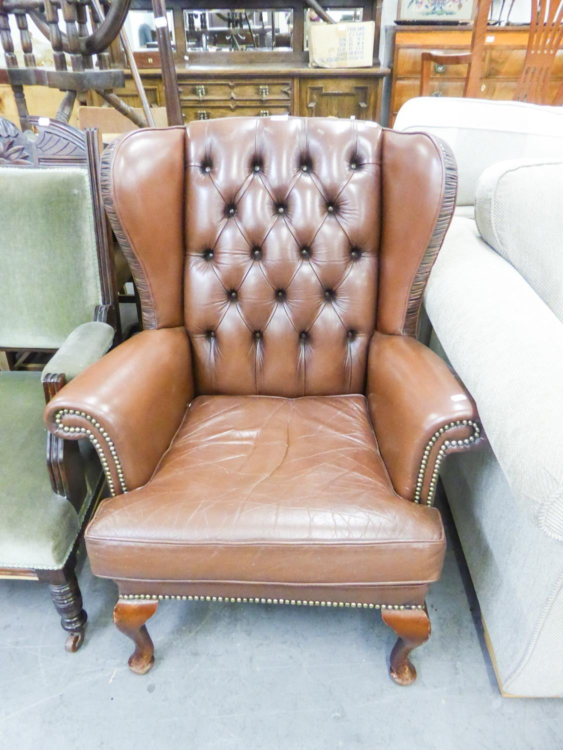 Lot 62 - A REPRODUCTION FIRESIDE ARMCHAIR, WITH BROWN HIDE UPHOLSTERY AND BUTTON BACK, A REPRODUCTION