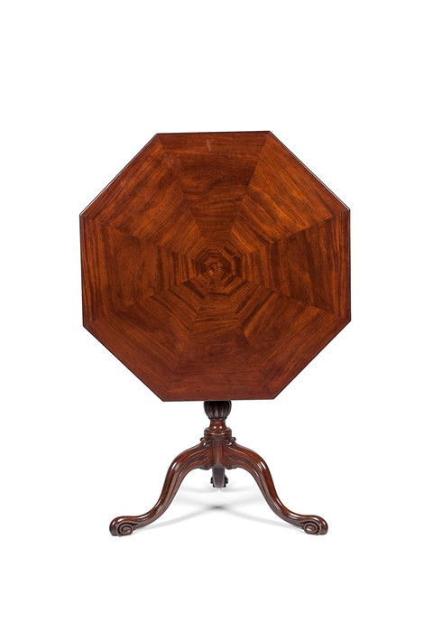 Lot 95 - A George III carved mahogany octagonal tripod table attributed to Thomas Chippendale