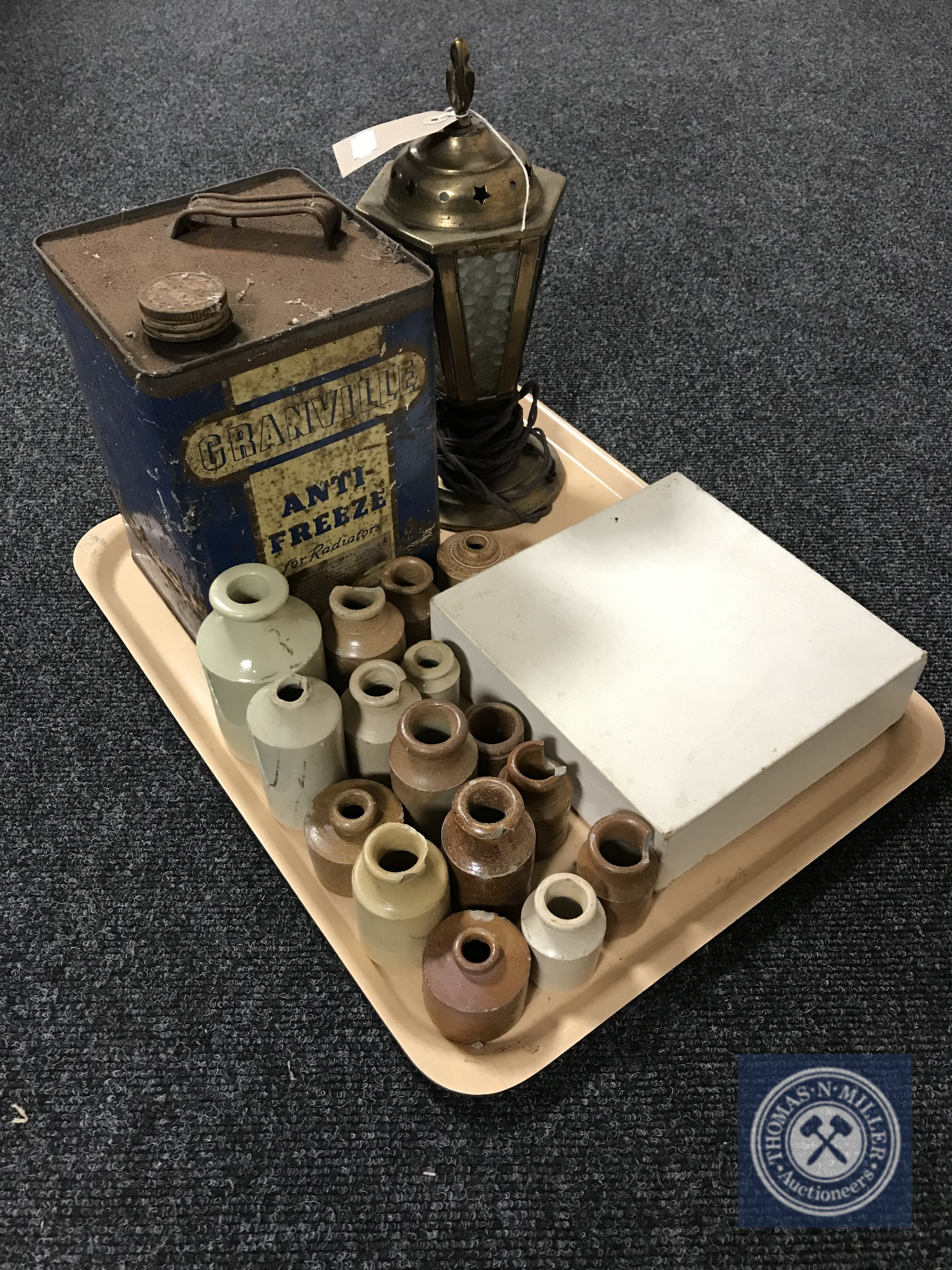Lot 15 - A tray of early twentieth century brass lamp, Granville anti freeze tin,
