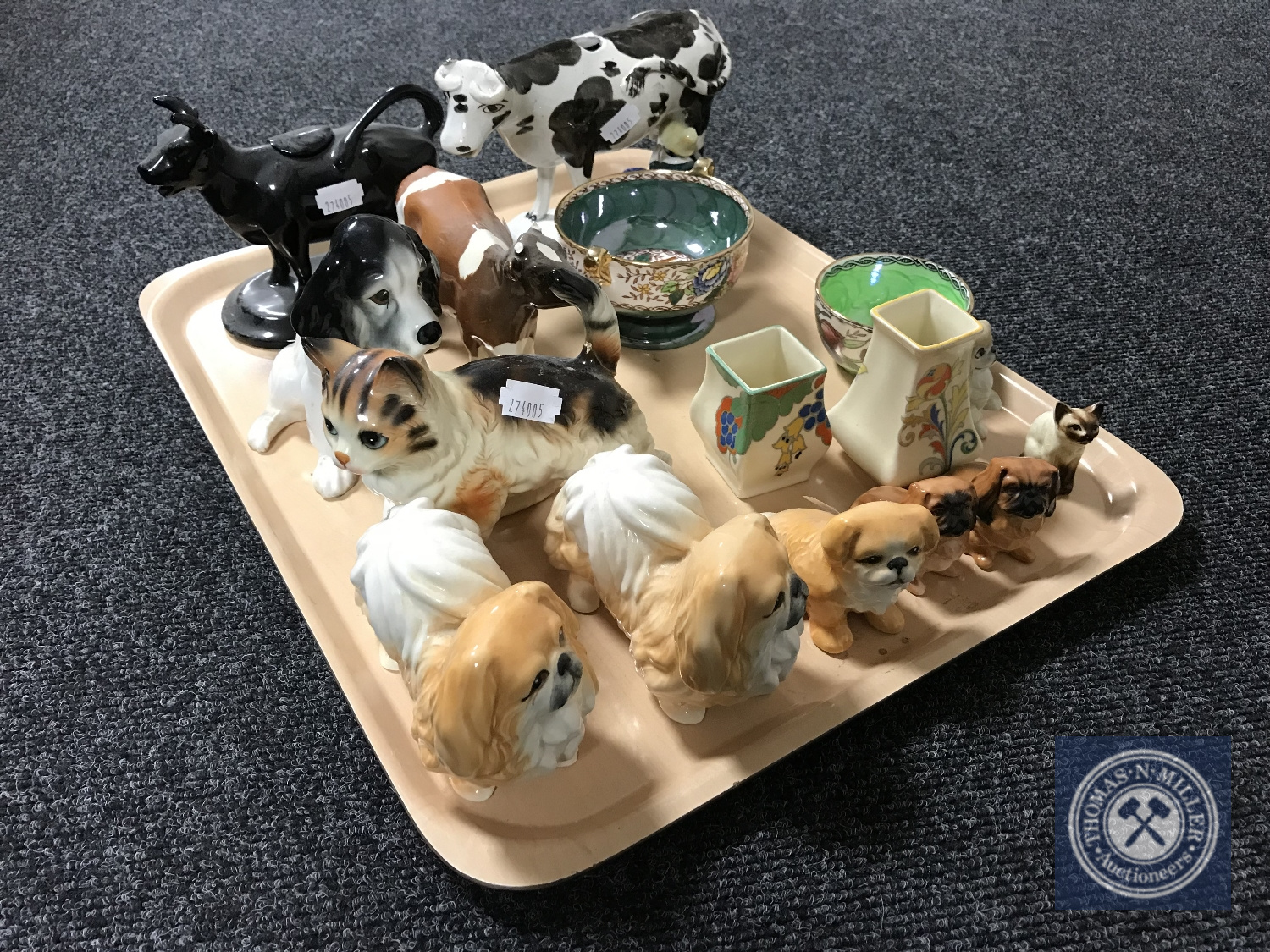 Lot 8 - A tray of 19th century cow creamer, together with of assorted china animal figures,