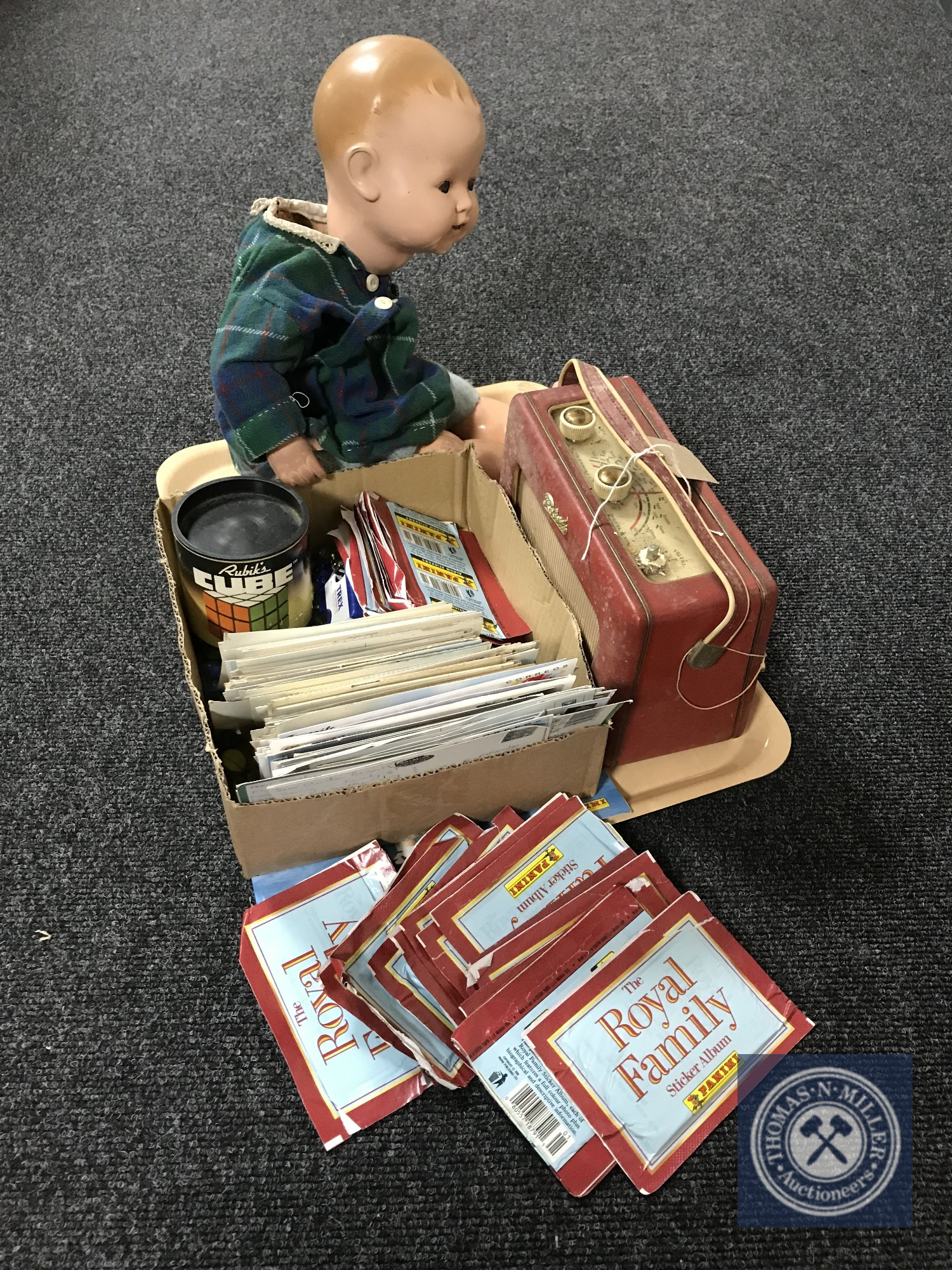 Lot 14 - A tray of antique doll, Roberts radio, marbles,