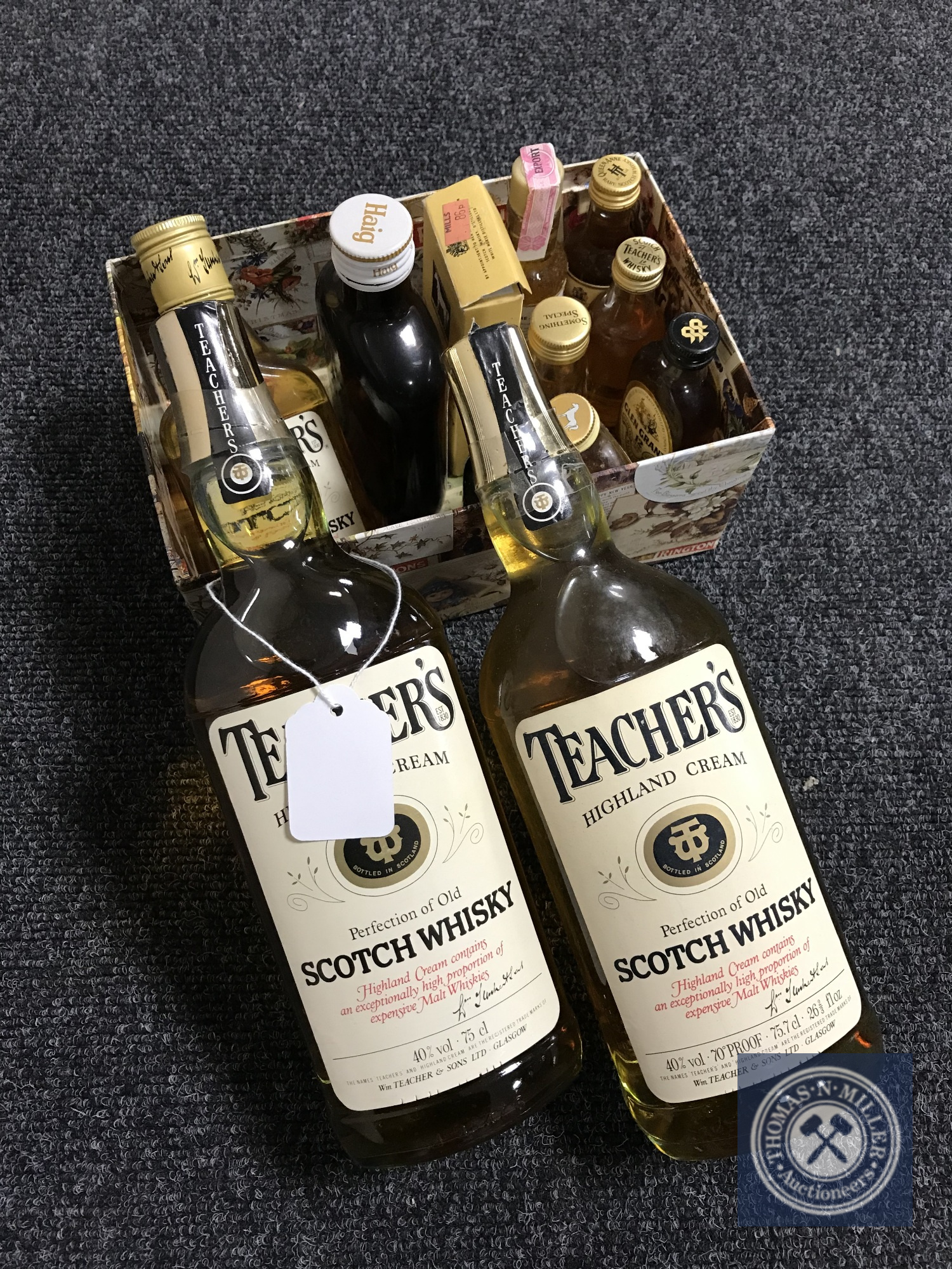 Lot 3 - Two 75cl of Teacher's Scotch Whisky together with a box containing two 18cl bottles of whisky and
