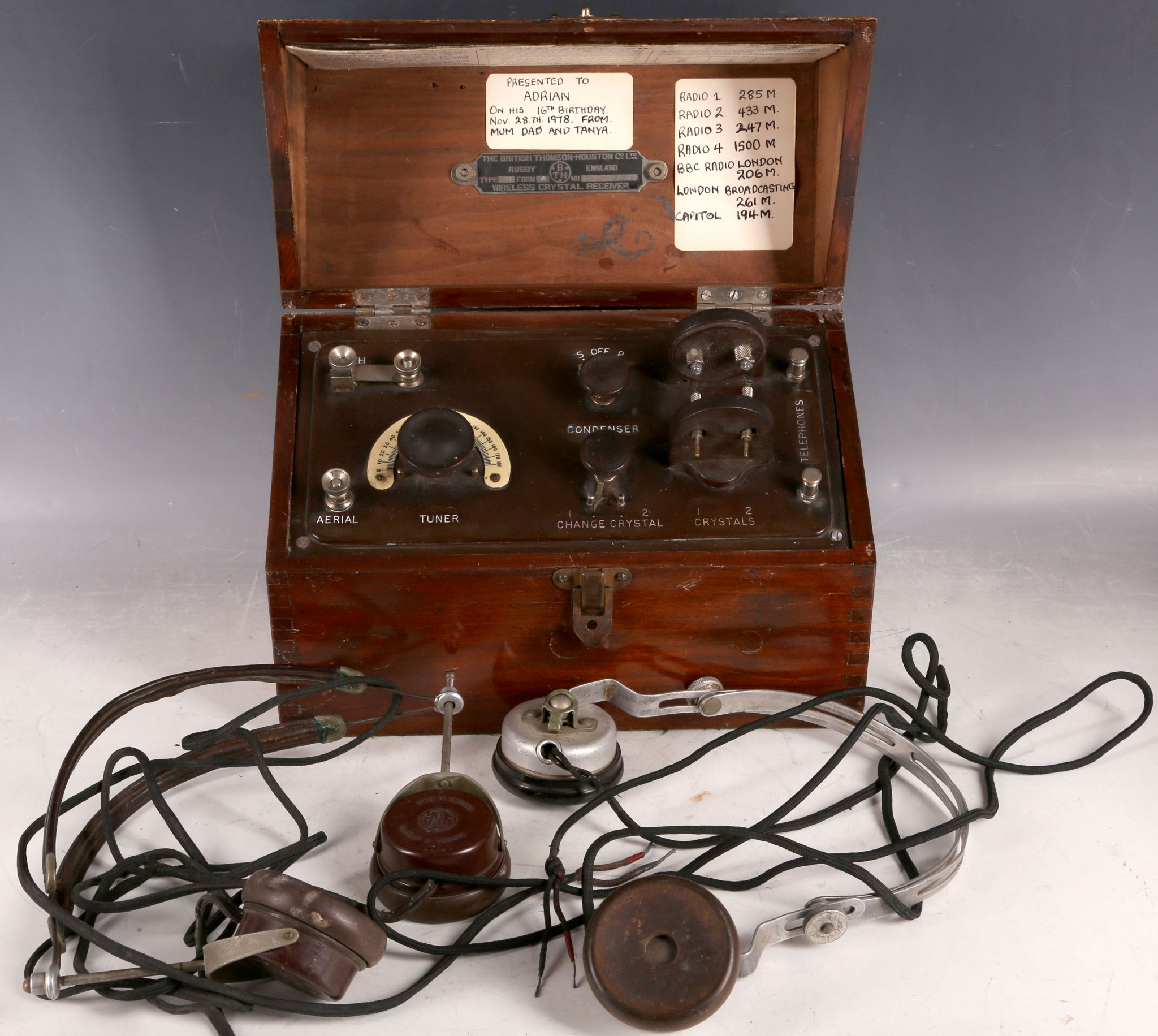 A mahogany cased British Thomson-Houston wireless crystal receiver and two pairs of earphones. (3)