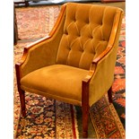 A box side easy chair, button back, mahogany frame, tapering chamfered legs.