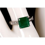 An 18ct white gold, emerald and diamond set ring (em. 3.40ct, dia. 0.47ct).
