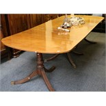 A mid 20th Century mahogany dining table, in Regency style, with three pedestals and central leaf,