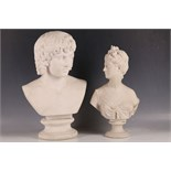 A 20th Century bust of a young Roman Emperor, possibly Antinous. Together with another bust of