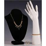 A 22ct gold and seed pearl necklace, with floral roundel links and sapphire drop, together with
