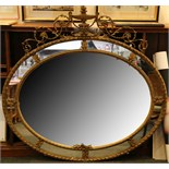A 19th Century overmantel mirror, flaming urn with acanthus trailing set above ribbon twist