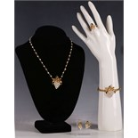 A suite of 22ct gold, sapphire and pearl set jewellery, comprising hinged bangle, necklace, earrings