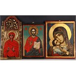 Three late 19th / early 20th Century icons, one representing Madonna and Child, measuring 36 x 28cm,