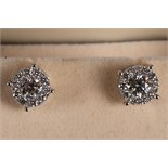 A pair of 18ct white gold and diamond multi-cluster ear studs with screw backs.