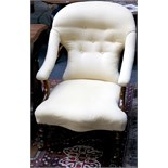A Victorian rosewood button back easy chair, in yellow upholstery, raised on turned legs and