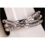 A 'Pascal' 18ct white gold and diamond set cross-over ring, boxed.