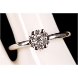 An 18ct white gold and diamond cluster illusion set ring.