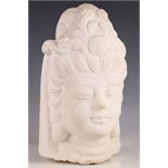 After the Antique, white granite carved head of a Cambodian Buddha.