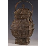 A Chinese archaic form bronze jar of temple design, scrolls and temple dogs to lid, insects to