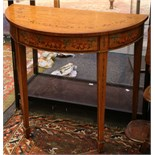 A Sheraton Revival demi-lune satinwood table, with painted decoration, supported on square tapered