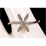 An 18ct white gold and diamond set floral dress ring.