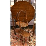 A tilt-top mahogany occasional table, on pedestal base with carved tri-form legs. Sold together with