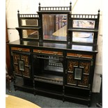 A Victorian Aesthetic Movement ebonised, mirror backed chiffonier, stamped Edwards & Roberts, with