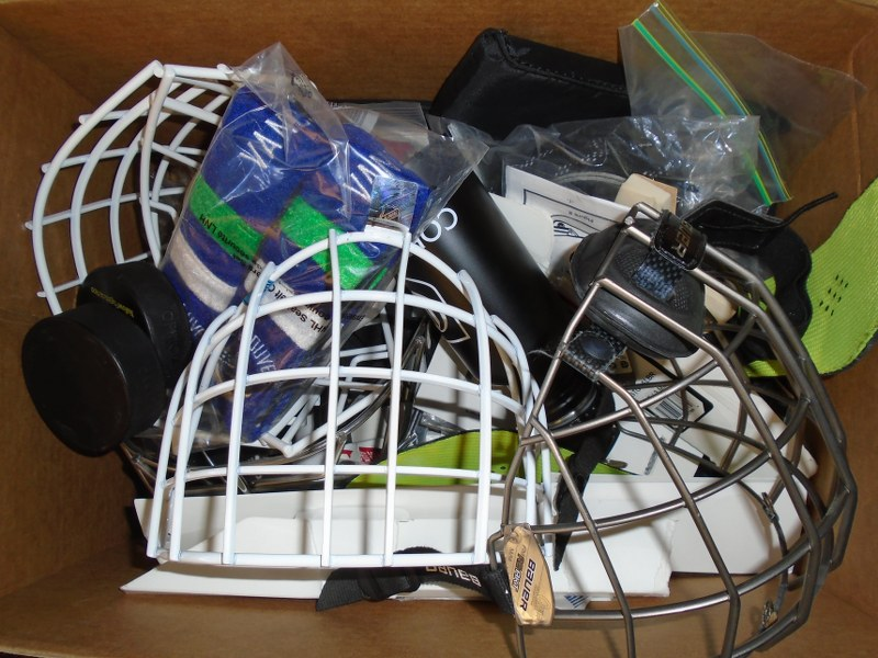 Lot 16 - Box of Misc Hockey parts