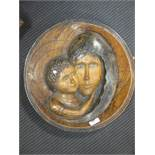 A carved oak roundel with the face of the Madonna and Child, modern, 38 cm diameter
