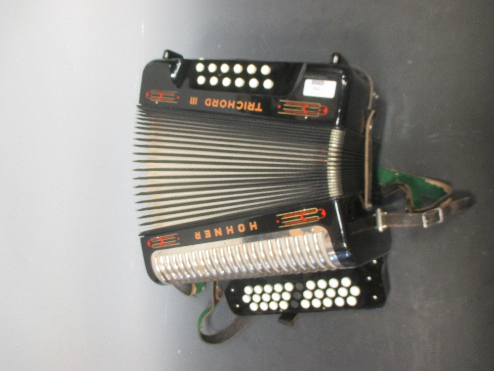 Lot 161 - A Hohner Trichord III accordion, cased