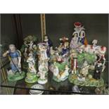 A group of 19th century Staffordshire figures to include the 'Pig Tythe' group, a figure of a