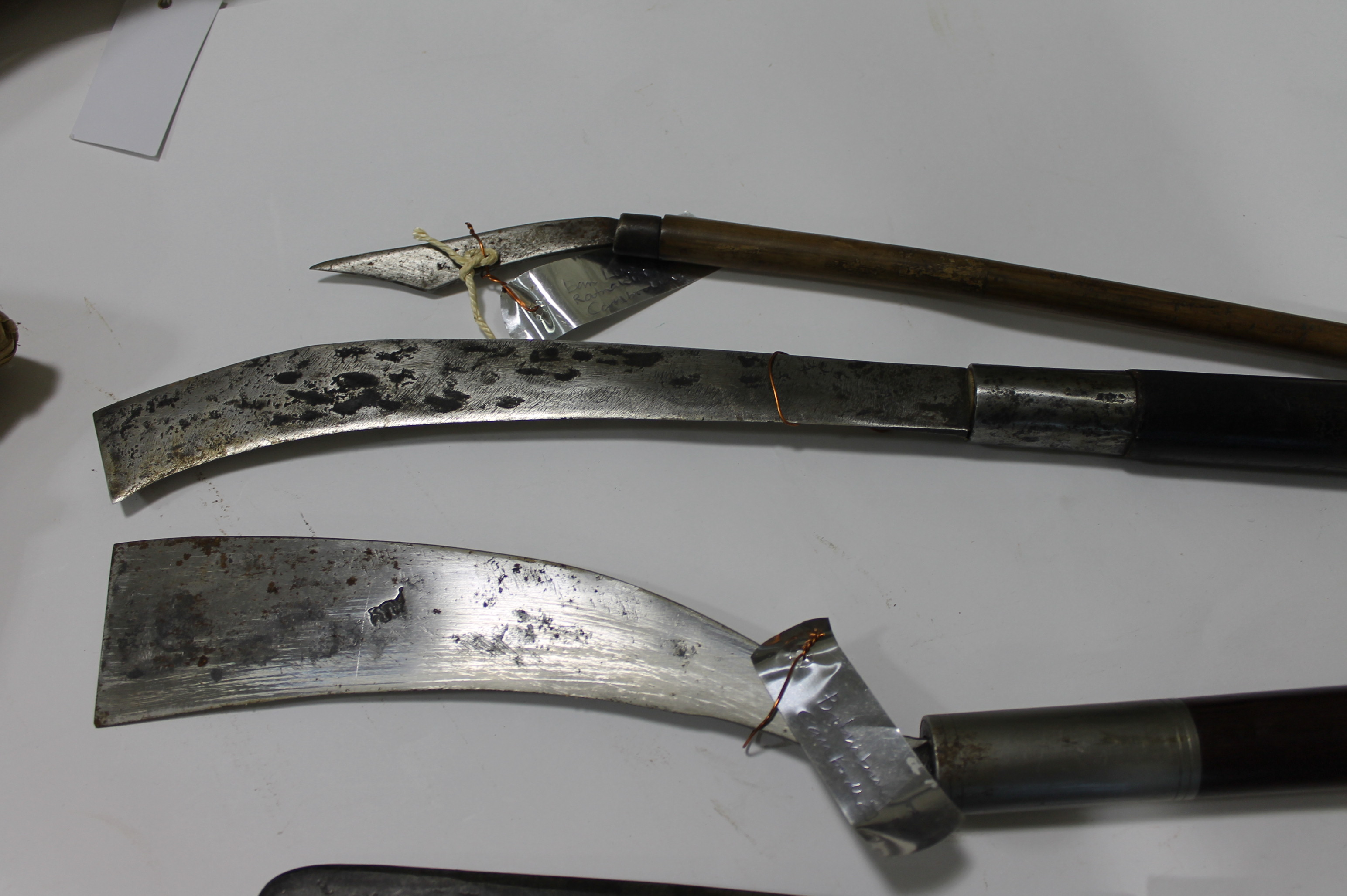 """Lot 42 - EASTERN KNIVES. Five Eastern knives including a Cambodian Machete style knife with a 10"""" blade,"""