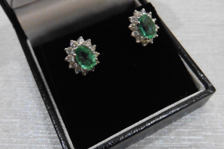 Lot 11 - 1.60CT EMERALD AND DIAMOND CLUSTER STYLE STUD EARRINGS.