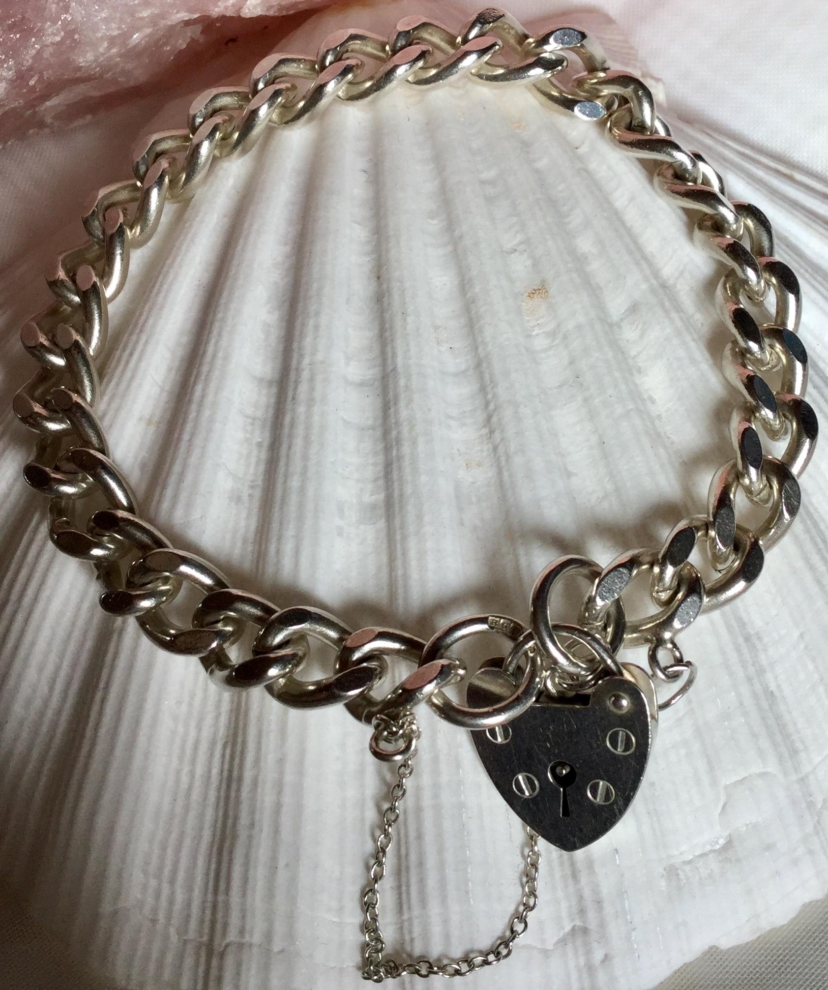 Lot 1 - English Vintage 925 Silver Charm Bracelet Heart Clasp English Hallmarks 30.89 grams