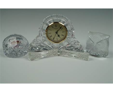 A Waterford Crystal clock, 18 cm x 12 cm, together with a Wedgwood paperweight, a Nubro Swedish owl paperweight and a pair of