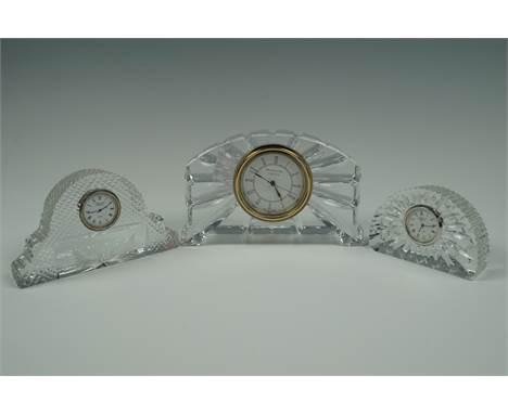 A Waterford and two Edinburgh Crystal clocks, former 17 cm x 11 cm