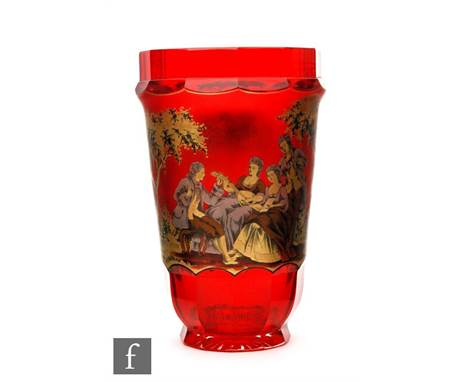 An early 20th Century Bohemian ruby glass vase of tumbler form with slice cut base and rim, the body enamel and gilt decorate
