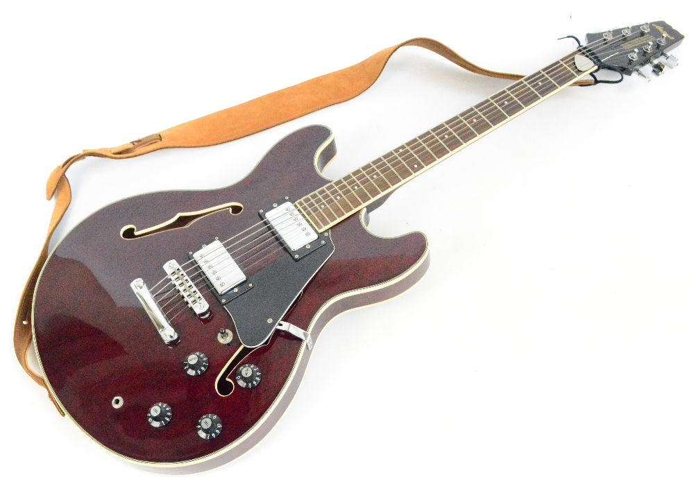 An Aria Pro II Semi Acoustic Guitar With Six Metal Strings