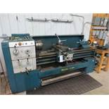 Enco lathe with power feed, three jaw 10in chuck, steady rest, extra 12in four jaw chuck, 3 1/4in ho