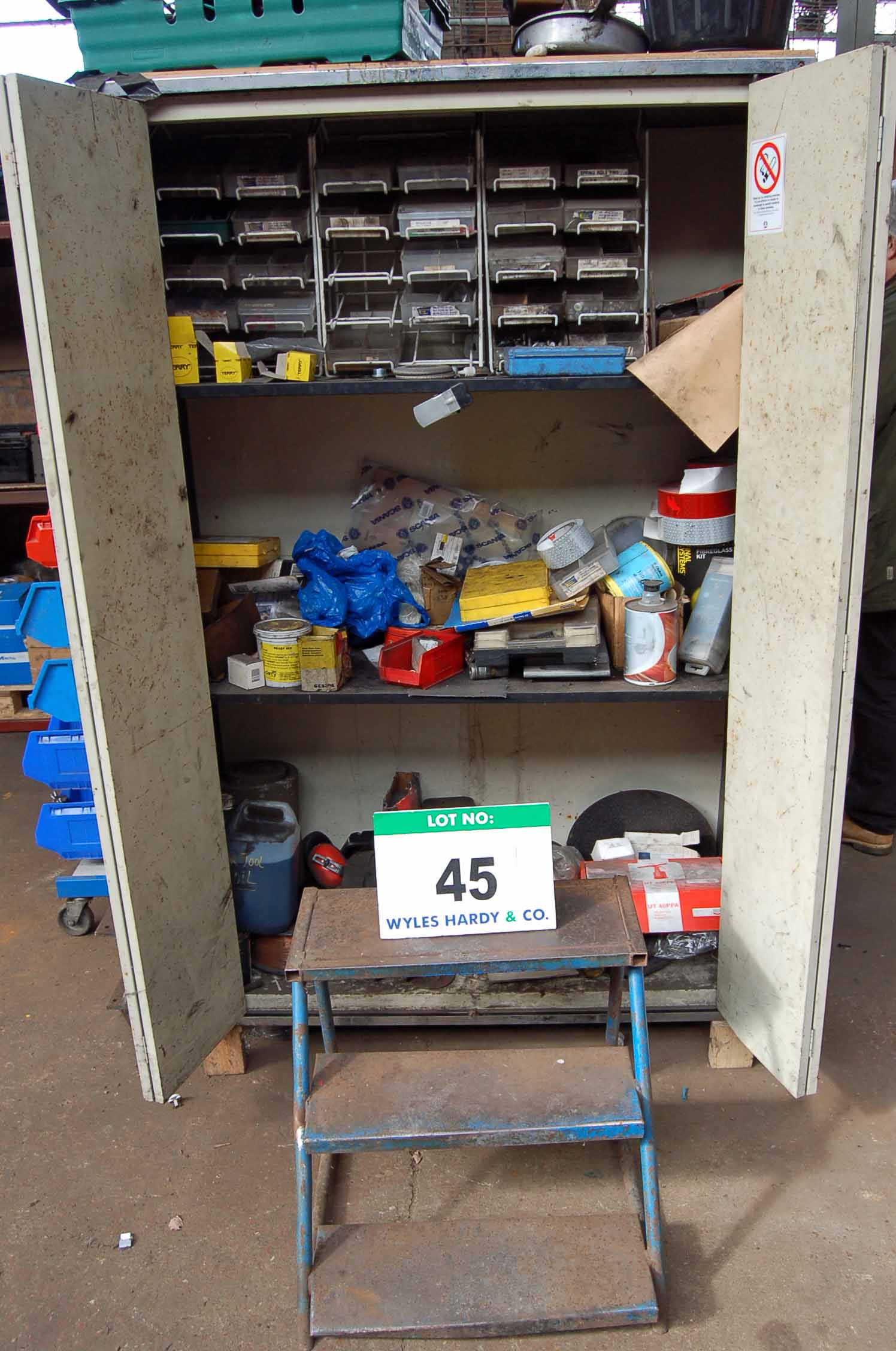 Lot 45 - A Cream Steel 2-Door Cupboard with Contents comprising Various Nuts, Bolts, O-Rings, Rivets and A