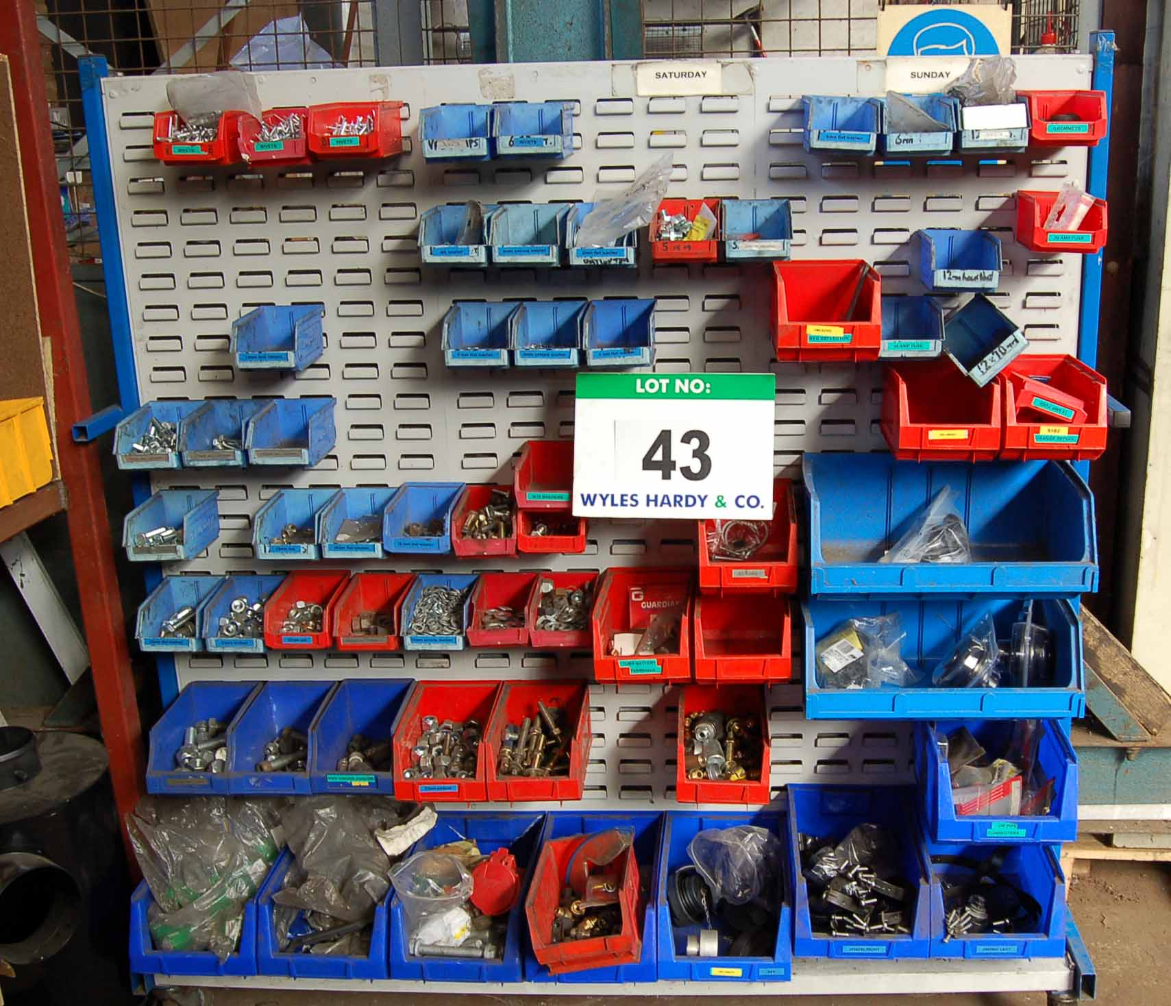 Lot 43 - A Mobile Steel Double Sided LIN BIN Rack with Approx. Sixty Five Various Plastic LIN BINS with