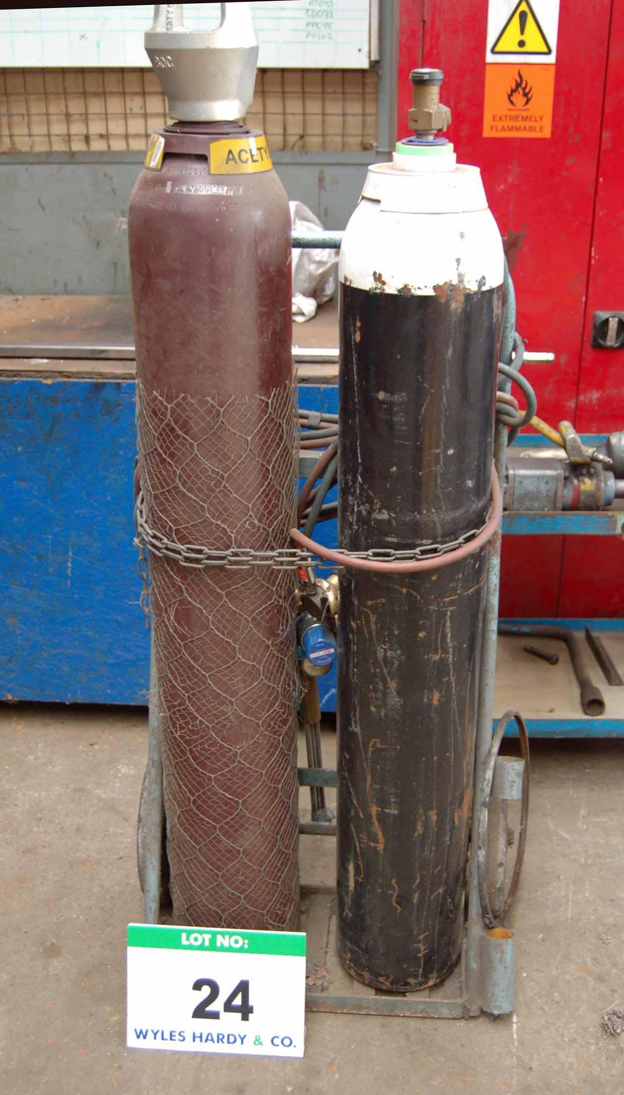 Lot 24 - An Oxy-Acetylene Welding Set with Steel Twin Bottle Trolley Regulators, Hose and Lance (Bottles