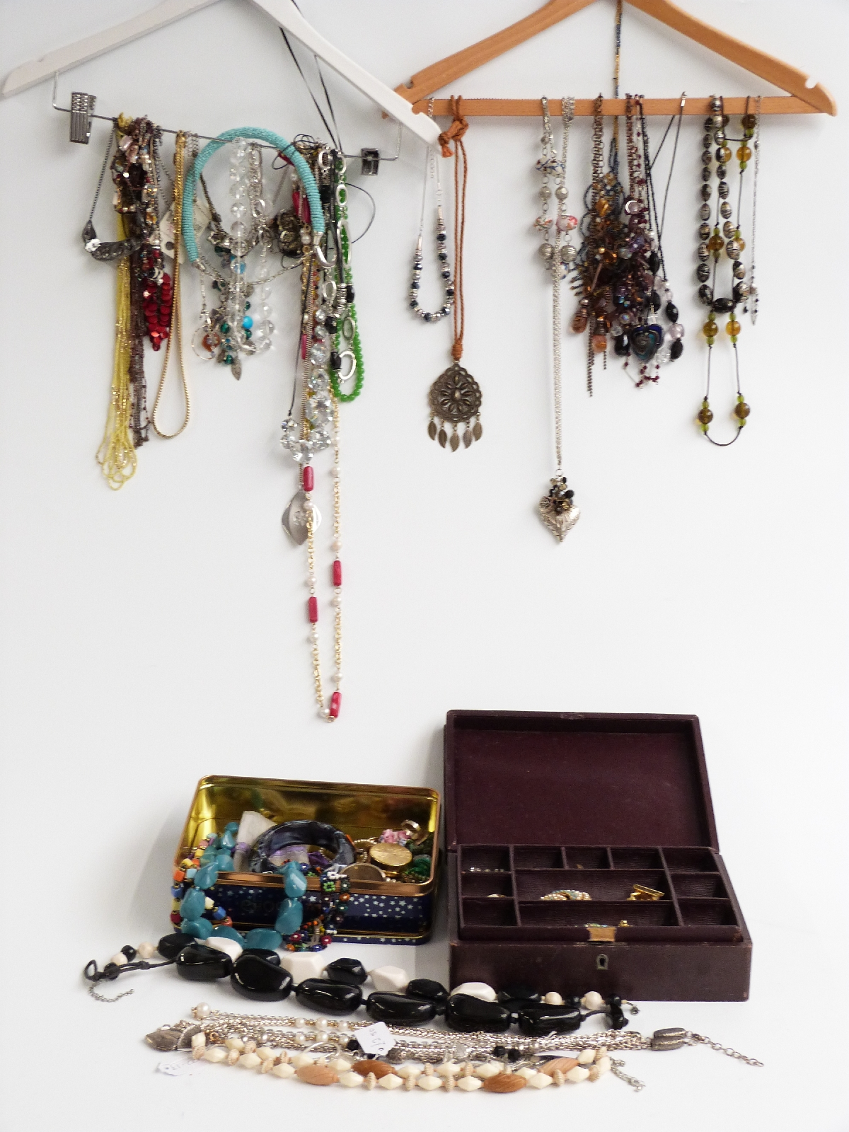Lot 9 - A collection of costume jewellery including necklaces, brooches, abalone bangle, etc
