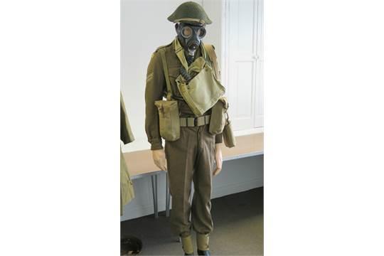 A British military WWII Norfolk Regiment uniform with helmet