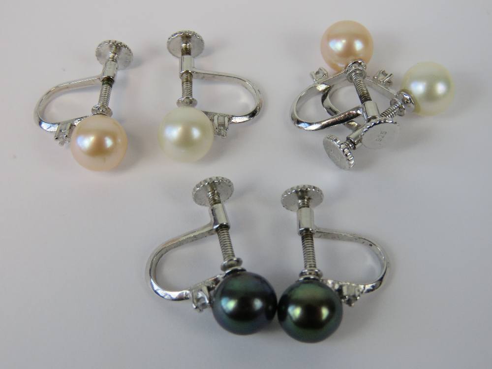 Lot 68 - Three pairs of silver and pearl screw ba