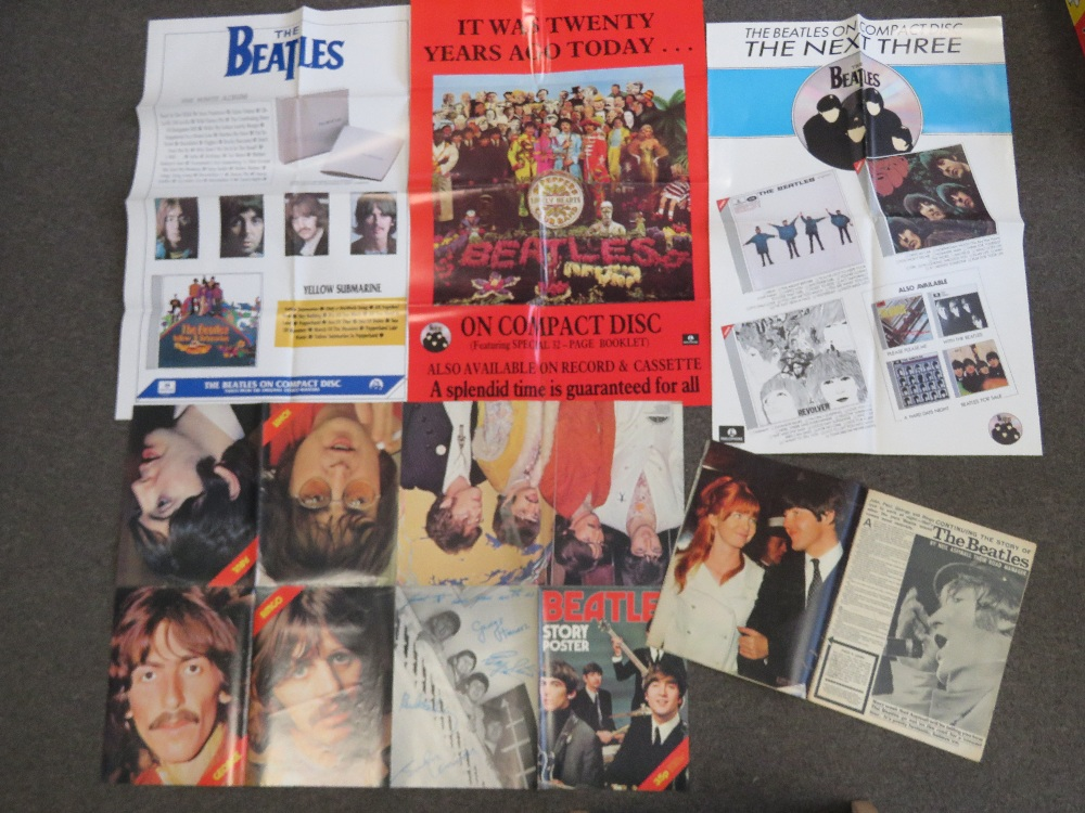 Lot 655 - Beatles; story poster, together with a c