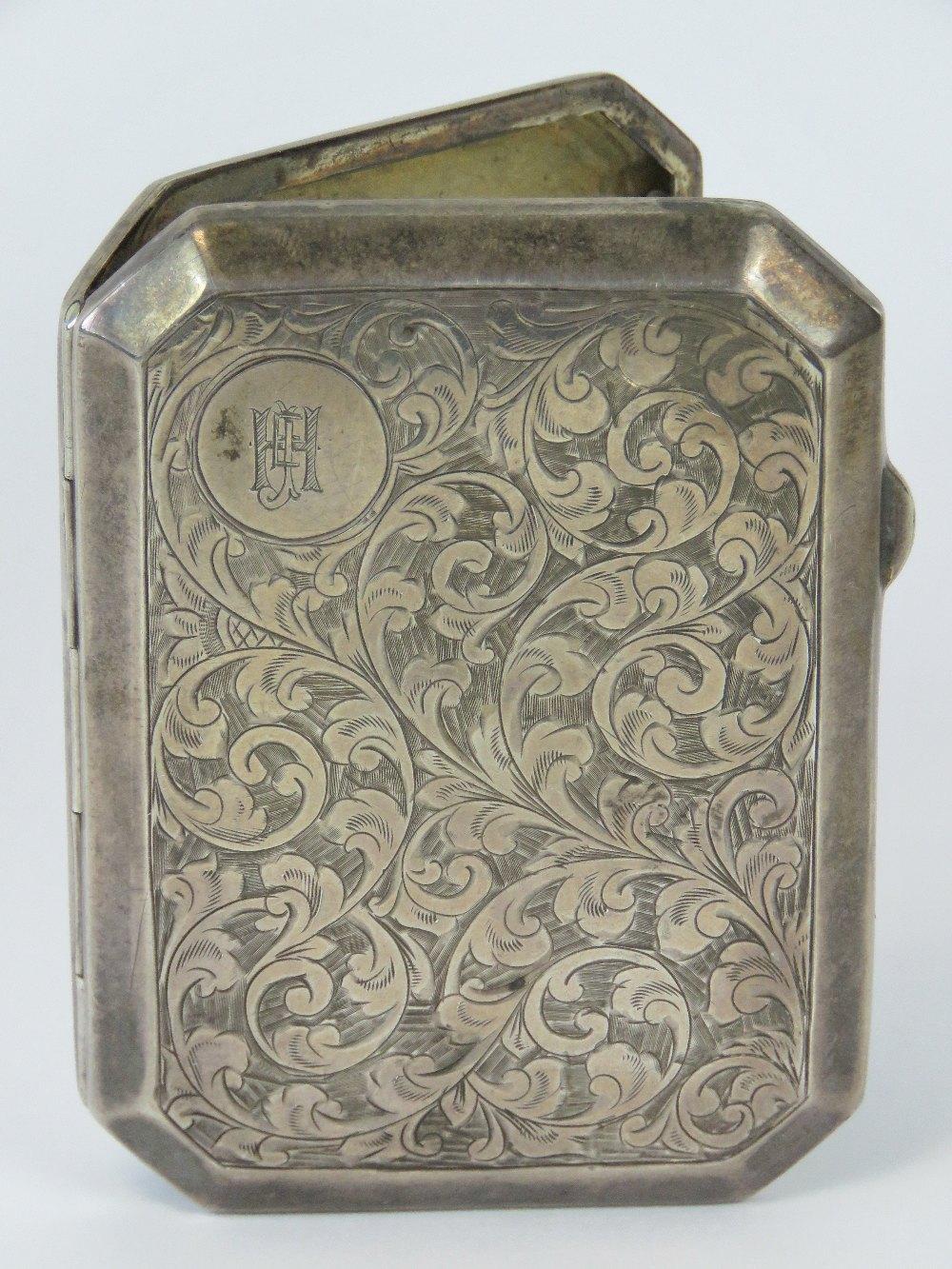 Lot 34 - A HM silver octagonal cigarette case, en
